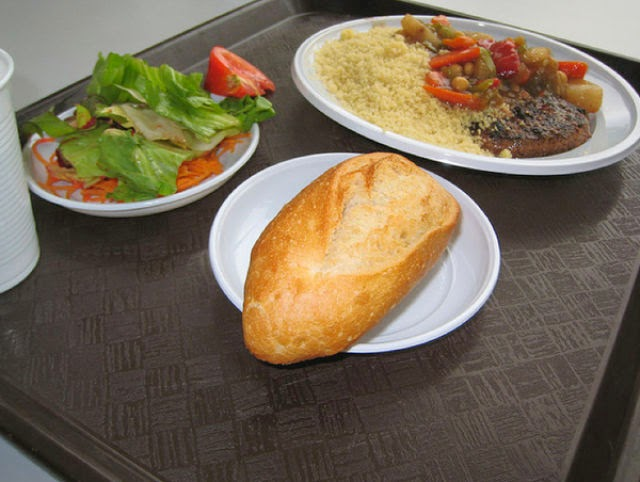 Country: France Contents: Baguette, salad, couscous, mixed veggies in sauce, meat.
