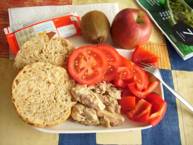 Country: Slovakia Contents: Smoked mackerel, bread, red pepper and tomato salad, kiwi, apple, and a milk cake.