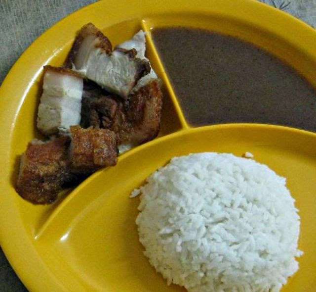 Country: Philippines Contents: Lechón kawali, liver sauce, rice.