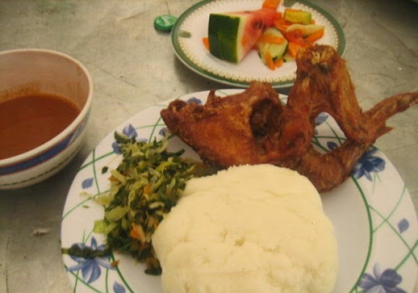 Country: Tanzania Contents: Ugali, chicken, greens, dipping sauce, watermelon salad.