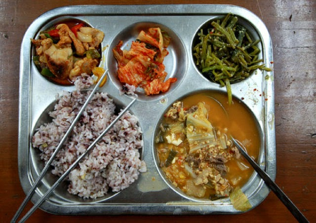 Country: South Korea Contents: Mixed grains and rice, stinky bean stew, mixed and fried chicken and vegetables, simmered seaweed a.k.a. steamed green beans, and cabbage kimchi.